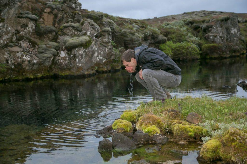 drinking-fresh-water-from-silfra-lake-iceland-1024x683