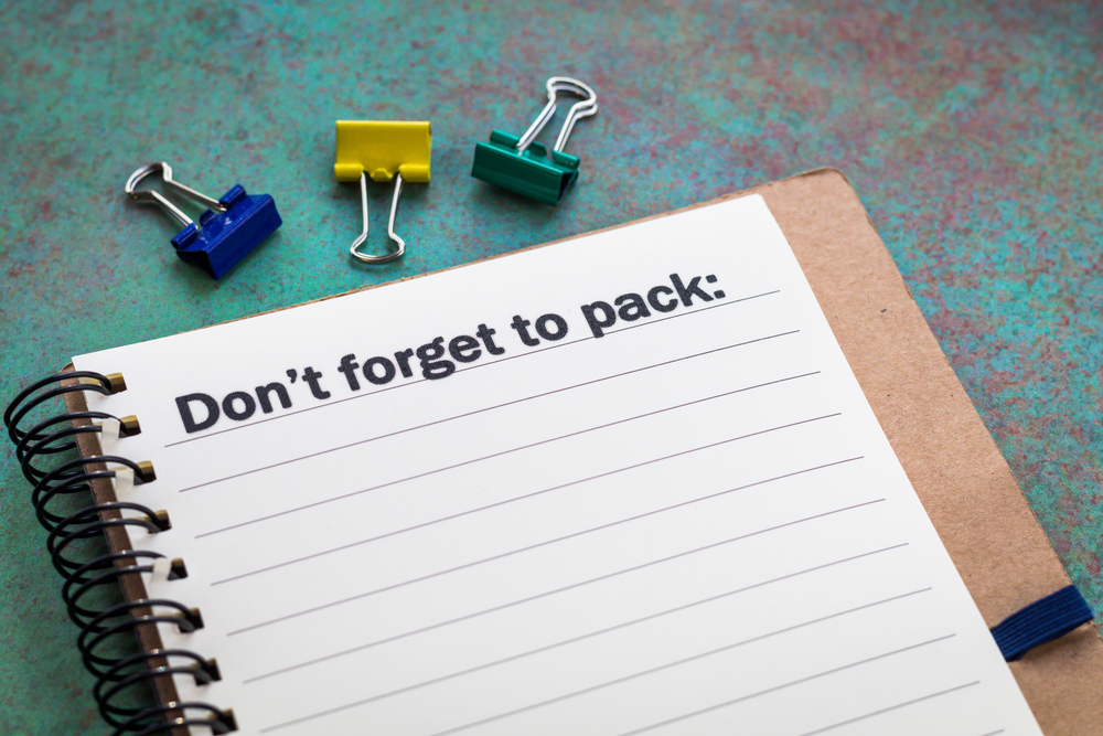 Checklist notepad to write what to pack for a vacation in Iceland