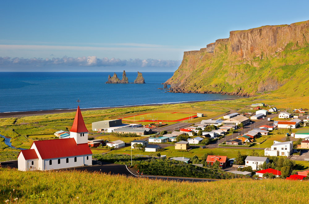 View of ocean and church in Vik, Iceland