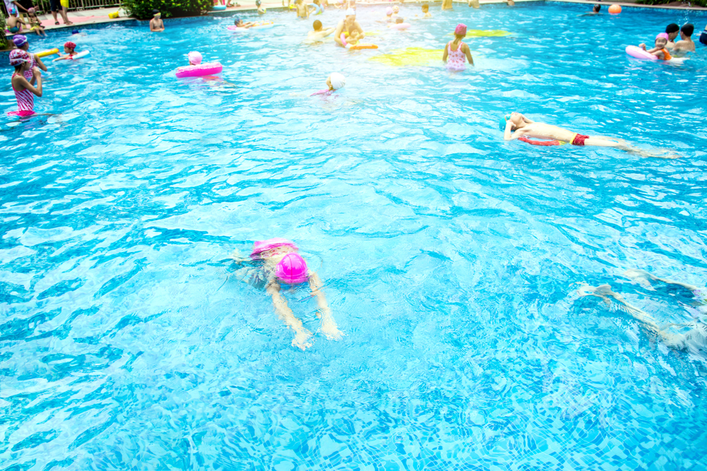 People swimming at Borngarnes Swimming Pool