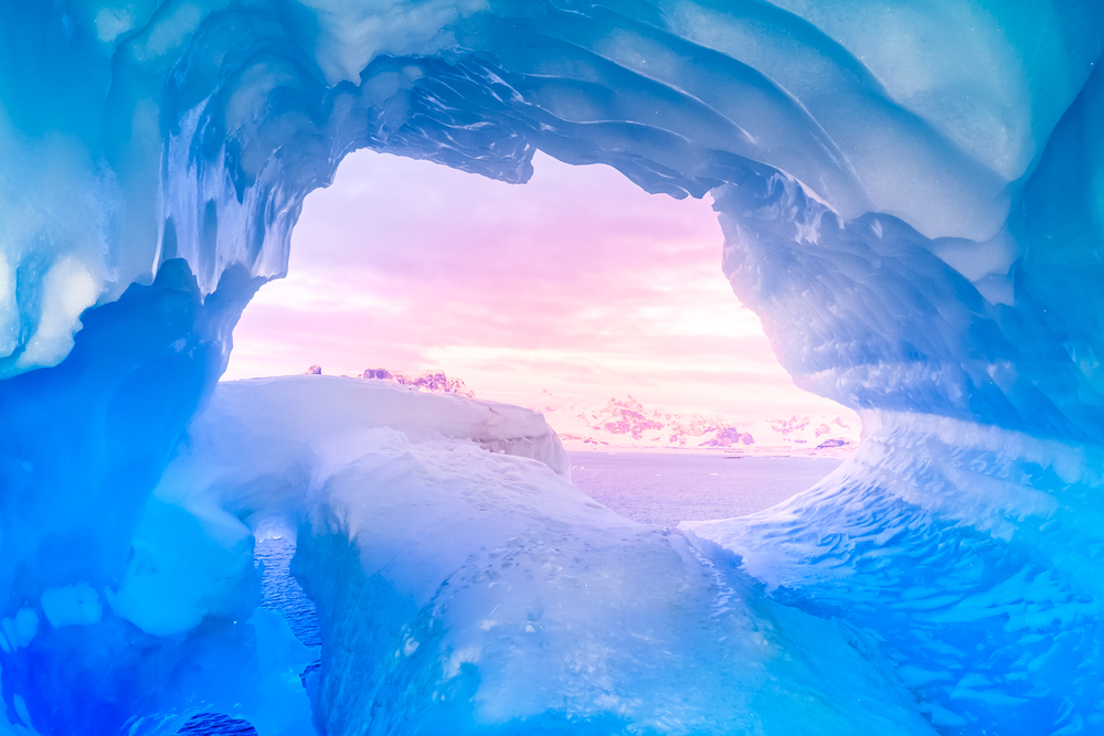 View from ice cave in Iceland with romantic sunset