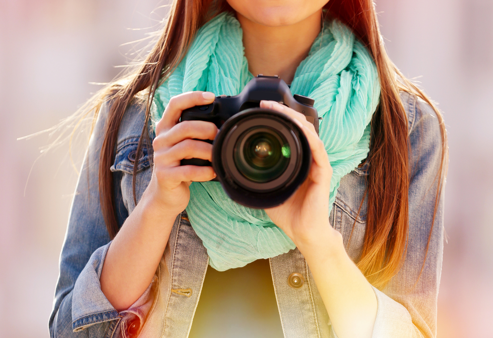Iceland Travel Photography Tips Young Woman with Camera