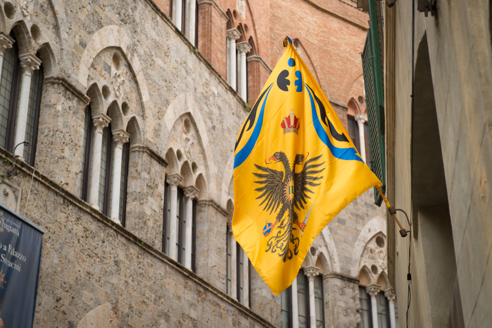 Flag of the alquila (eagle) in Siena, Italy
