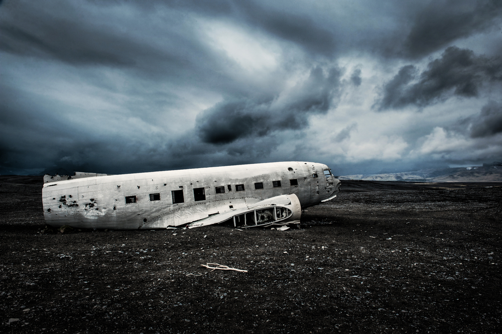 Haunting image of DC-3 plane crash fuselage on black sand beach of Sólheimasandur in Iceland