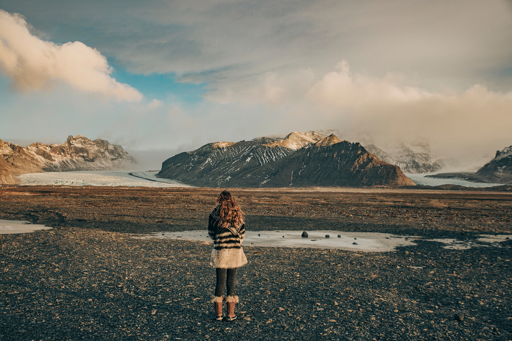 Woman standing at entrance to Skaftafell area of Vatnajökull National Park