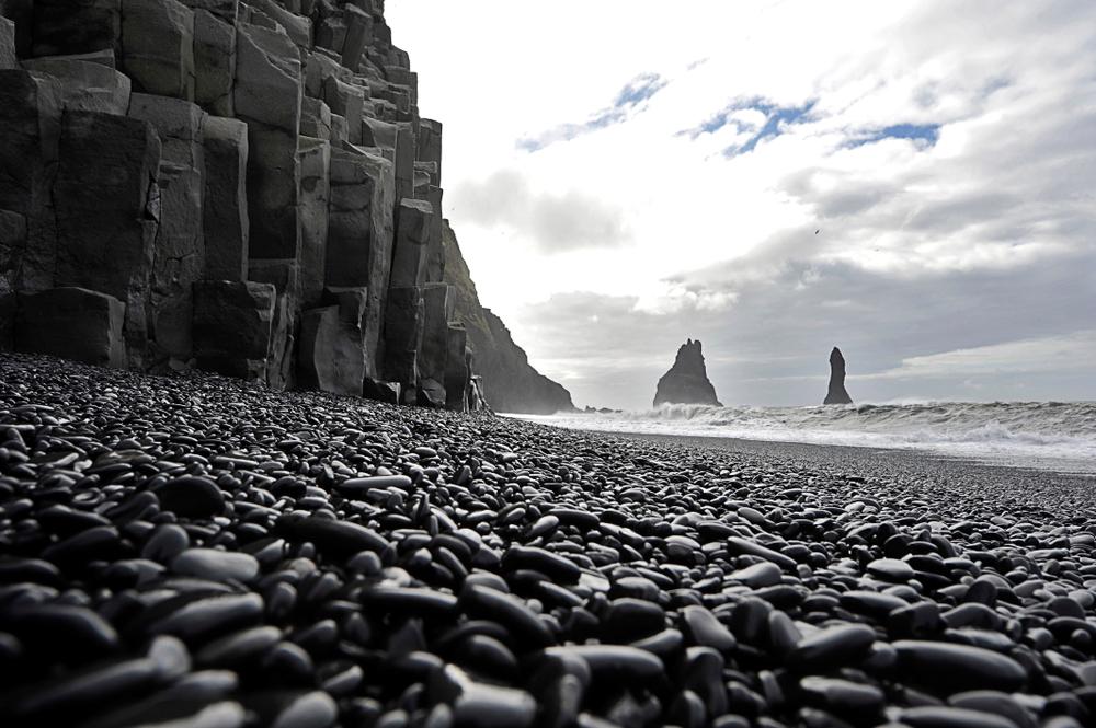 Vík's black sand and black pebble volcanic beaches