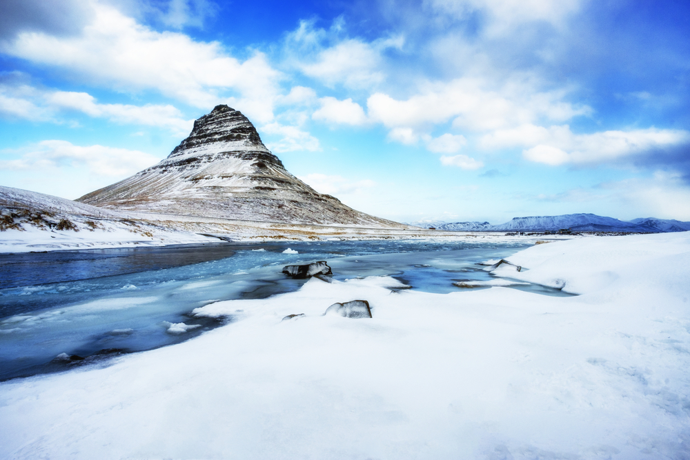 An icy winter view of Kirkjufell during low season in Iceland