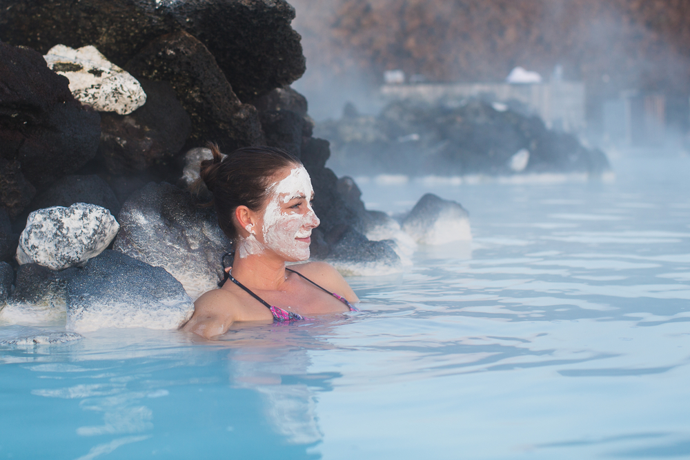 Woman with a silica face mask treatment at Iceland's Blue Lagoon