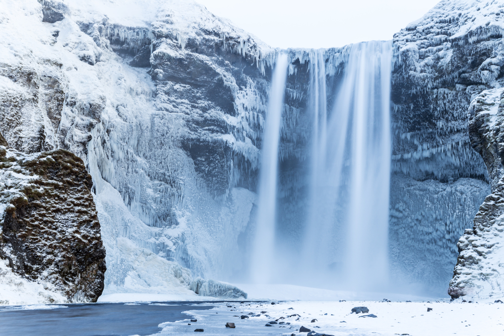 Frozen Skógafoss waterfall in the winter