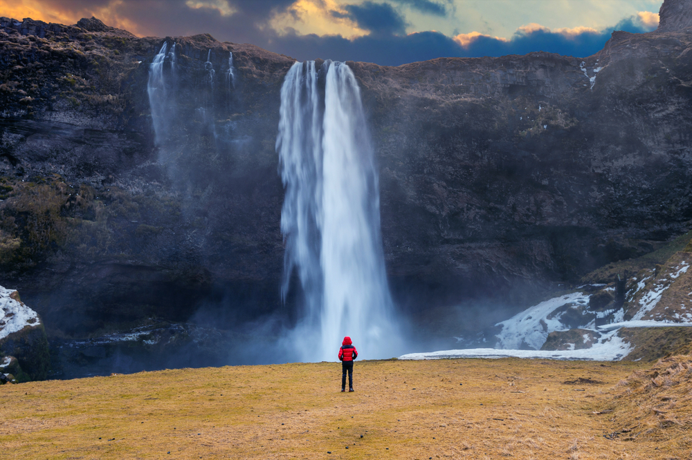 Solo travel in Iceland means you make your own schedule like this visit to a waterfall