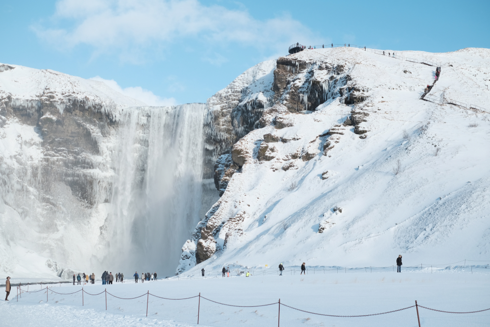 Winter is great time to visit Iceland and see frozen waterfalls like Skógafoss