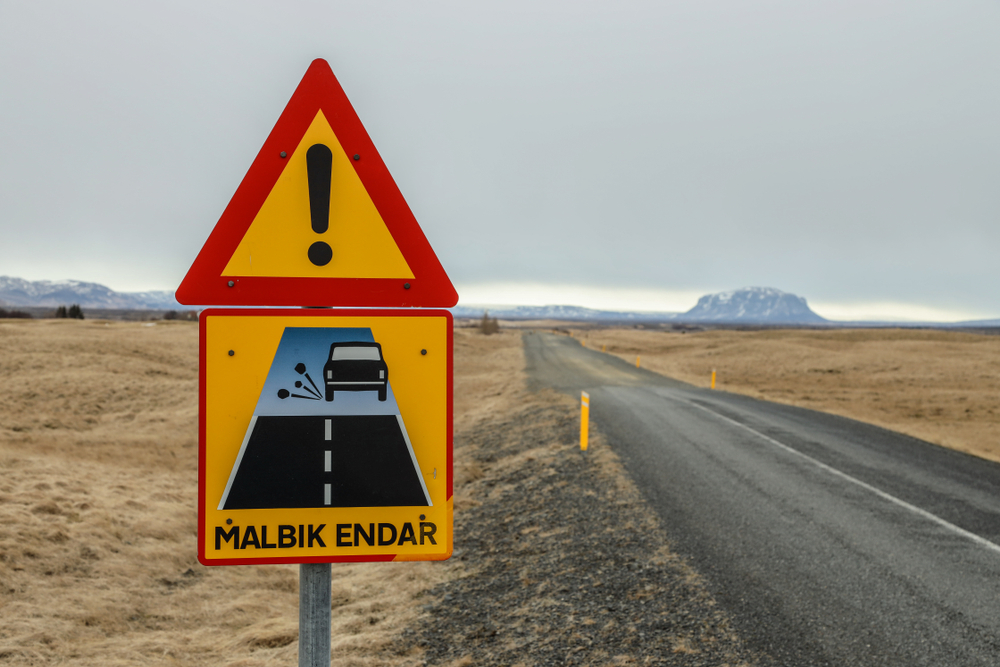 Malbik Endar road sign in Iceland where paved road changes to gravel