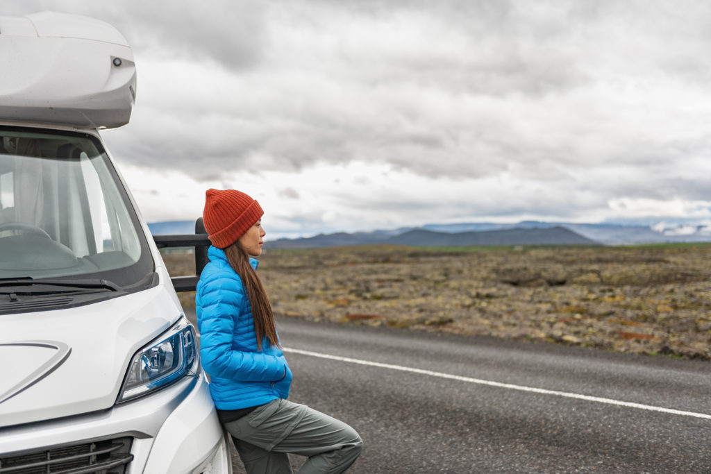 woman laying on a motorhome by the Icelandic road